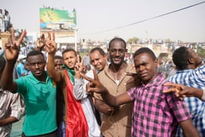 Demonstrators take part in a protest demanding the departure of Sudanese president, Omar al-Bashir, as they wait for an announcement outside the Sudanese Army headquarters