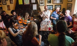 Fiddle and Irish music fans from around the world, including Japanese play in a small village pub