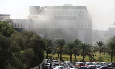 Smoke rises from the Libya's National Oil Corporation headquarters in Tripoli.