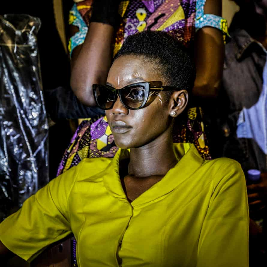 A model waits backstage during Dakar fashion week, June 2017