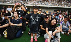 Locals attend a fans' event in Kashiwa before the World Cup kicks off. New Zealand are the two-time defending champions.