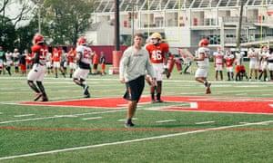 Chris Ash surveys practice at Rutgers