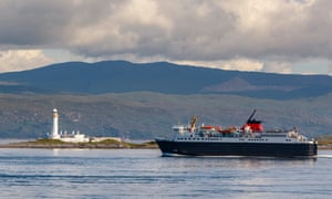 A ferry from Oban passes a lighthouse on Lismore.