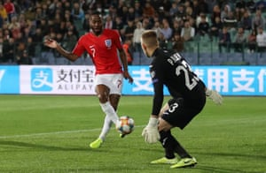 Raheem Sterling side-foots in the fourth after an England counterattack.