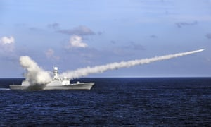A Chinese frigate launches a missile during a 2016 military exercise in the South China Sea