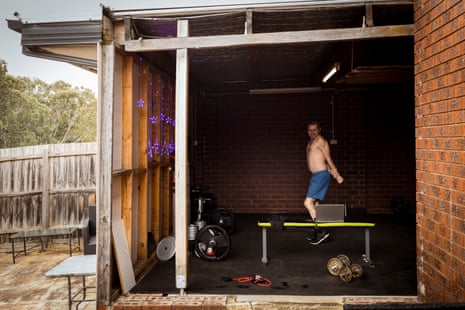 An exterior view of Jason Whiter's home gym – inside he is skipping in front of a laptop.
