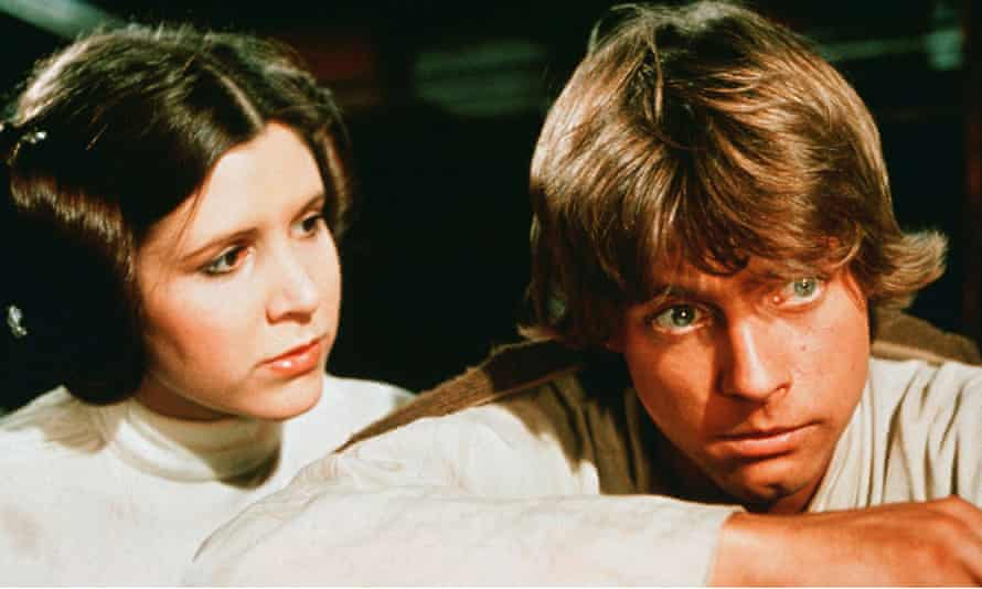 Hamill with Carrie Fisher in the first Star Wars film in 1977.