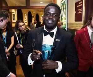 Daniel Kaluuya holds his EE Rising Star award backstage at the Baftas