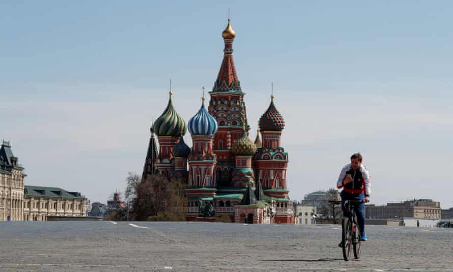 A lone cyclist rides through an almost completely empty Red Square in Moscow on 1 May.