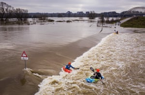 Kayakers make the most of floodwaters on the Waal River, Nijmegen, Netherlands