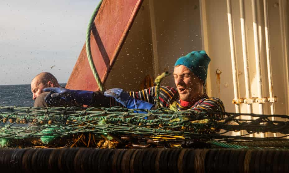 Edgar Vimba struggles to pull in the fishing net.