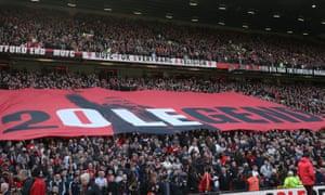 A banner celebrating Ole Gunnar Solskjaer is displayed in the Stretford End