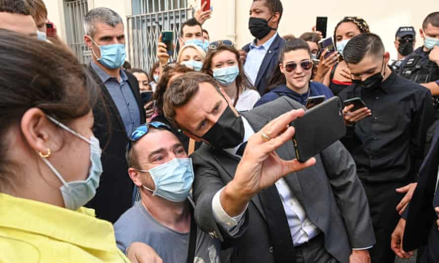 Emmanuel Macron poses for a selfie with residents of Valence, France