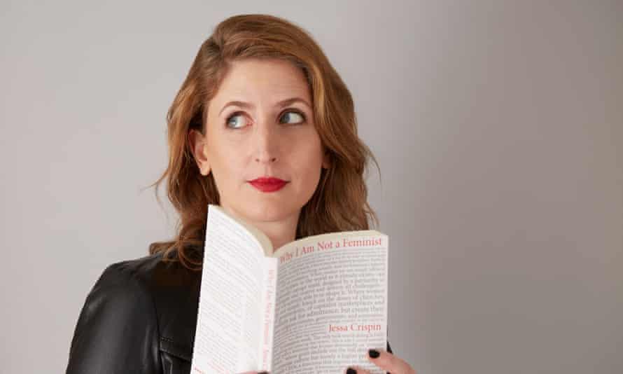 Jessa Crispin holding her book