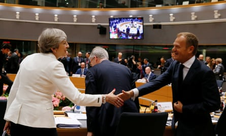 Theresa May shakes hands with Donald Tusk at the EU summit in Brussels.