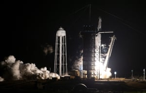 A SpaceX Falcon 9 rocket carrying the company's Crew Dragon spacecraft launches for Nasa's SpaceX Crew-1 mission.