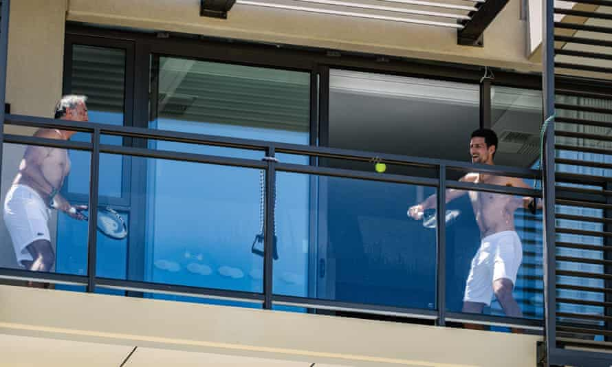 Novak Djokovic prepares for the Australian Open by playing tennis on his balcony in quarantine in Adelaide