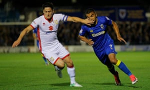 Williams hands off Kwesi Appiah of AFC Wimbledon during the recent League One game between the rival clubs, which MK Dons won 2-0.