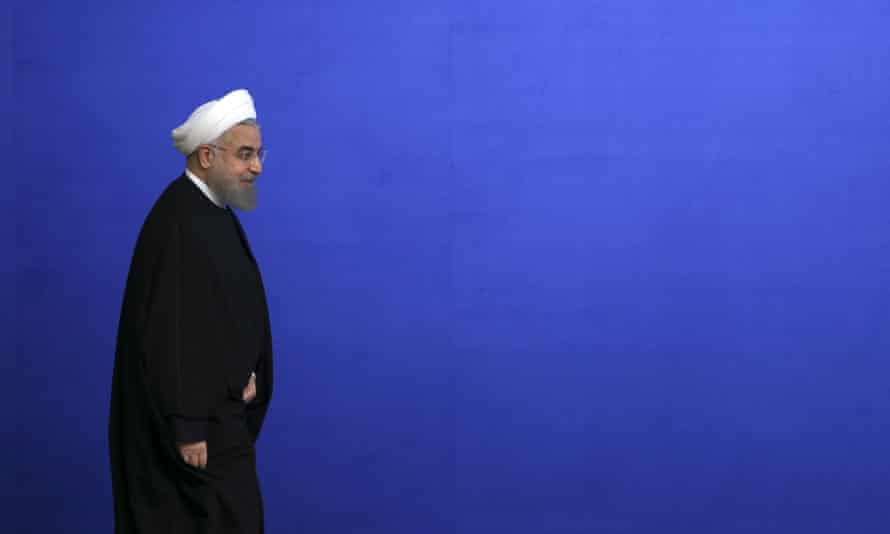 Iranian President Hassan Rouhani arrives for his press conference in Tehran.