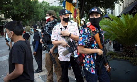 A Texas Guerrillas member who calls himself 'Apex', third from right, and others carry weapons at a Black Lives Matter rally in Austin, Texas.
