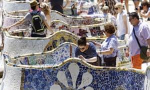 Tourists visit Spanish architect Gaudi's Park Guell in Barcelona.
