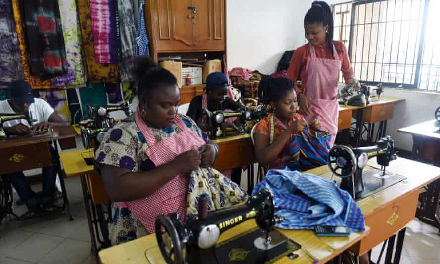 Women sew clothes at Idia Renaissance non-governmental organisation in Benin-city, Edo State, midwest Nigeria.