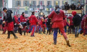 Teams take part in the traditional battle of the oranges held during the Ivrea carnival.