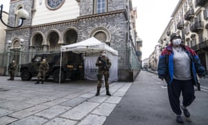 Soldiers guard the streets in Turin amid Italy's nationwide lockdown