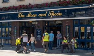 Customers at the Wetherspoon Moon and Spoon pub in Slough.