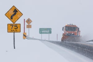 A snowplough clears the road after a dump of snow on the Snowy Mountains Highway near Kiandra