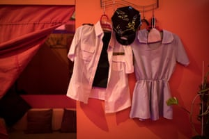 Uniforms hanging up in a Chinese brothel in Madrid