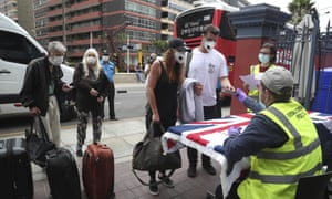 British citizens present their documents today before being bussed to the airport for a flight home in Lima, Peru.