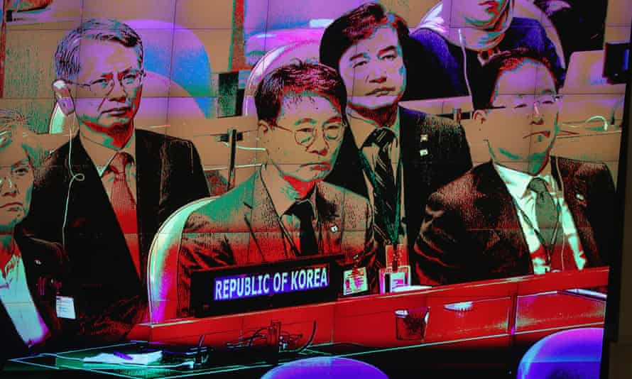 The delegation from North Korea, seen on a video screen, watches the president of South Korea address the UN earlier this week.