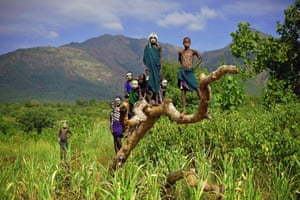 Children from the Suri tribe pose in Ethiopia's southern Omo Valley region near Kibish