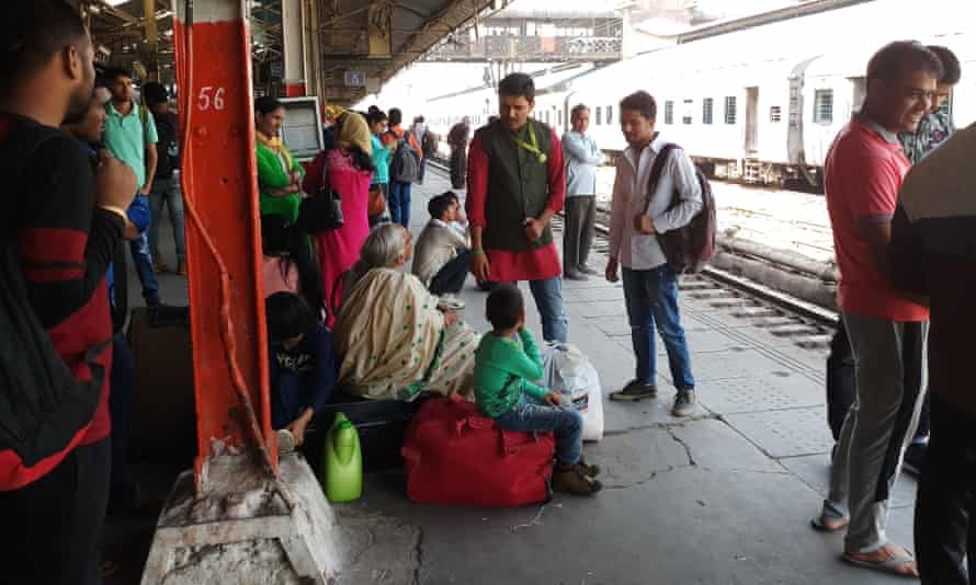 Ajish checking children on a platform at Old Delhi railway station