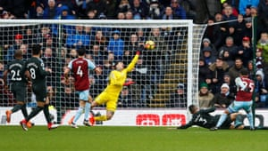 Aaron Lennon's shot is tipped onto the post by Ederson.