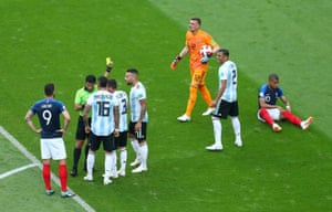 Argentina's Nicolas Tagliafico is shown a yellow card.