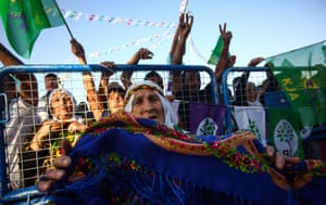Supporters of the Pro-Kurdish Peoples' Democratic Party wave flags during election celebrations in June.