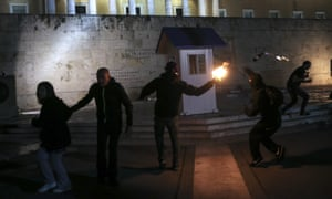 Greek protesters, including workers from public and private sectors, clash with police