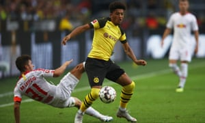 Jadon Sancho of Borussia Dortmund gets the better of RB Leipzig's Diego Demme.