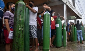 Relatives of patients infected with Covid-19 queue to refill oxygen tanks at the Carboxi company in Manaus, Amazonas state, Brazil. (Photo by Marcio James/AFP via Getty)