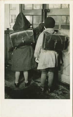 Photograph by Lisel Haas of two children wearing satchels. Born to Jewish parents, Haas fled Nazi Germany after Kristallnacht in 1938, abandoning her studio.