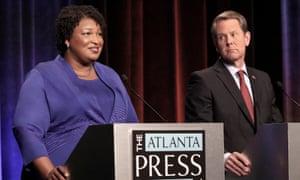 Abrams speaks as Brian Kemp looks on during a debate in Atlanta in October.