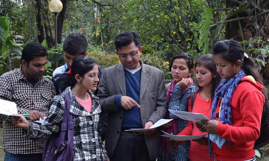 Nama Raj Budhathoki, executive director of KLL, teaching volunteers on how to use field papers (OSM paper maps) to navigate themselves in field.