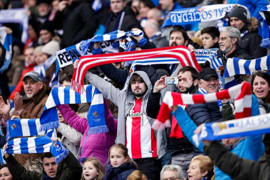 Supporters of Real Sociedad and Athletic Bilbao mixing during games