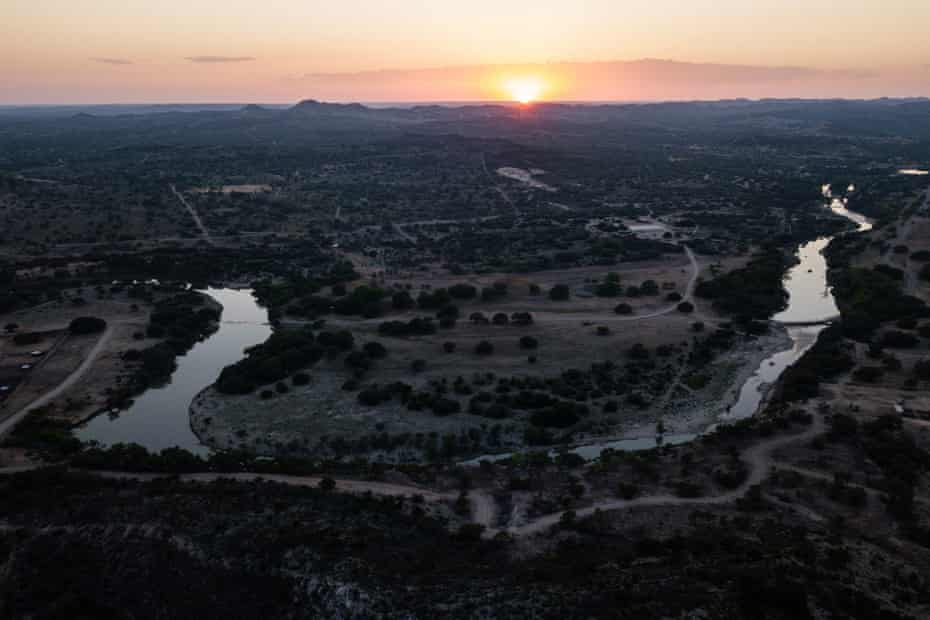 The sun sets over the Ox Ranch's 18,000 acres of Texas Hill country.