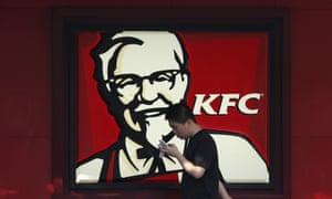 A man walks past a KFC restaurant in Shanghai, China.