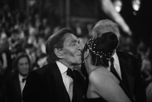 Salma Hayek greets the designer Valentino