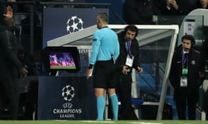 Referee Damir Skomina studies the VAR system prior to awarding Manchester United their dramatic late penalty at the Parc des Princes