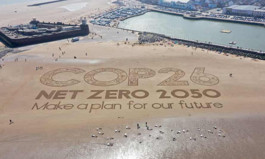 A giant Cop26 sand artwork adorns New Brighton Beach in Wirral, Merseyside.